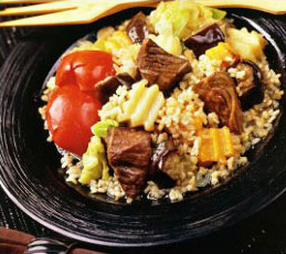 Говядина, тушенная с овощами и рисом